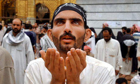 A Shia Muslim man in prayer in Iraq